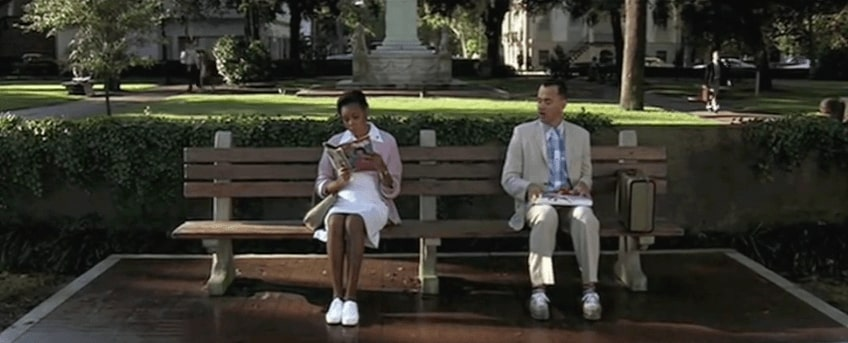 Scene from Forrest Gump, Forrest Gump sitting on chair and asking strangers about chocolates.