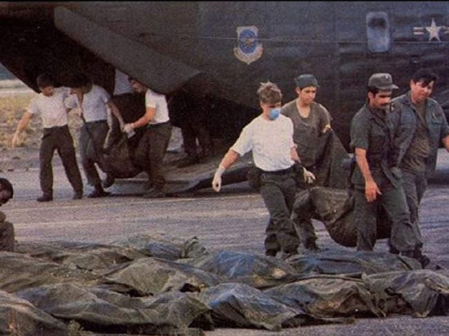 U.S. Military Officials removing the bodies.