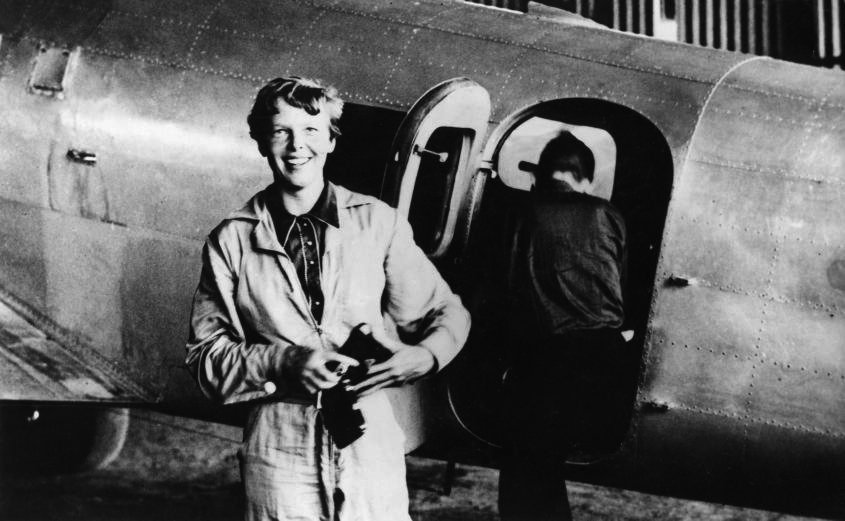 Earhart getting ready for one of her flights.